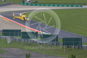 World © Octane Photographic Ltd. The TV helicopter making low passes. Friday 1st July 2016, F1 Austrian GP Practice 2, Red Bull Ring, Spielberg, Austria. Digital Ref : 1600CB5D3156
