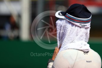 World © Octane Photographic Ltd. Williams Martini Racing, Williams Mercedes driver keeps cool. Sunday 28th August 2016, F1 Belgian GP Grid, Spa-Francorchamps, Belgium. Digital Ref : 1691LB1D2414