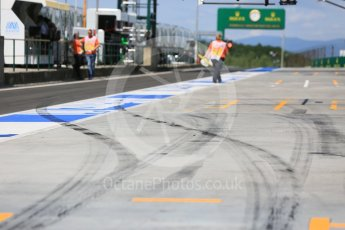 World © Octane Photographic Ltd. Tyre marks leaving a pit box. Friday 22nd July 2016, F1 Hungarian GP Practice 1, Hungaroring, Hungary. Digital Ref :