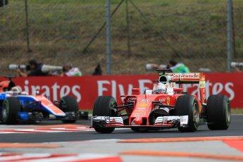 World © Octane Photographic Ltd. Scuderia Ferrari SF16-H – Sebastian Vettel and Manor Racing MRT05 - Pascal Wehrlein. Friday 22nd July 2016, F1 Hungarian GP Practice 1, Hungaroring, Hungary. Digital Ref :