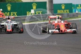 World © Octane Photographic Ltd. Scuderia Ferrari SF16-H – Kimi Raikkonen and Haas F1 Team VF-16 – Romain Grosjean. Saturday 23rd July 2016, F1 Hungarian GP Practice 3, Hungaroring, Hungary. Digital Ref :1647CB1D7613