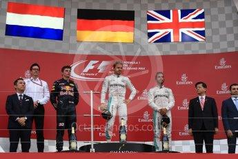 World © Octane Photographic Ltd. Mercedes AMG Petronas – Nico Rosberg (1st), Red Bull Racing – Max Verstappen (2nd) and Mercedes AMG Petronas – Lewis Hamilton (3rd). Sunday 9th October 2016, F1 Japanese GP - Podium. Suzuka Circuit, Suzuka, Japan. Digital Ref :1737LB1D8446