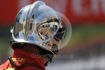 World © Octane Photographic Ltd. Reflection of pit lane in fire marshals helmet. Saturday 28th May 2016, F1 Monaco GP Practice 3, Monaco, Monte Carlo. Digital Ref : 1568LB1D9754