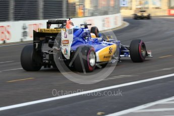 World © Octane Photographic Ltd. Sauber F1 Team C35 – Marcus Ericssonn and Manor Racing MRT05 - Pascal Wehrlein. Friday 16th September 2016, F1 Singapore GP Practice 1, Marina Bay Circuit, Singapore. Digital Ref :