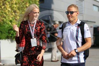 World © Octane Photographic Ltd. Williams Martini Racing – Valtteri Bottas and new wife Emilia Pikkarainen. Friday 16th September 2016, F1 Singapore GP Paddock, Marina Bay Circuit, Singapore. Digital Ref :1715CB1D5607