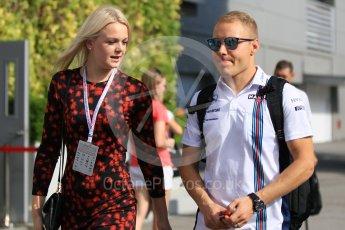 World © Octane Photographic Ltd. Williams Martini Racing – Valtteri Bottas and new wife Emilia Pikkarainen. Friday 16th September 2016, F1 Singapore GP Paddock, Marina Bay Circuit, Singapore. Digital Ref :1715CB1D5612