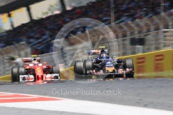 World © Octane Photographic Ltd. Scuderia Toro Rosso STR11 – Carlos Sainz and Scuderia Ferrari SF16-H – Kimi Raikkonen. Sunday 15th May 2016, F1 Spanish GP Race, Circuit de Barcelona Catalunya, Spain. Digital Ref :