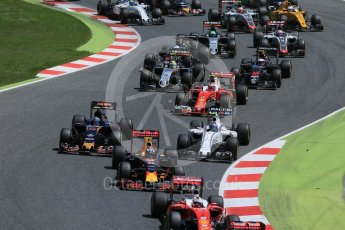 World © Octane Photographic Ltd. The pack heads through turns 1 and 2 on the 1st lap. Sunday 15th May 2016, F1 Spanish GP Race, Circuit de Barcelona Catalunya, Spain. Digital Ref :