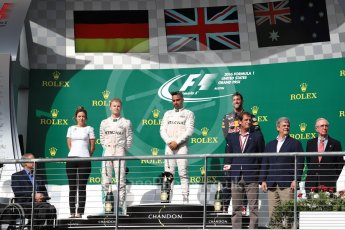 World © Octane Photographic Ltd. Mercedes AMG Petronas – Lewis Hamilton (1st) and Nico Rosberg (2nd) and Red Bull Racing – Daniel Ricciardo (3rd) with Victoria Vowels - Mercedes Partner Services Director. Sunday 23rd October 2016, F1 USA Grand Prix Podium, Austin, Texas – Circuit of the Americas (COTA). Digital Ref :1750LB1D4261