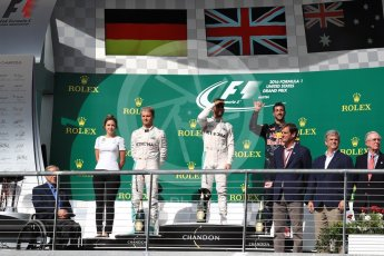 World © Octane Photographic Ltd. Mercedes AMG Petronas – Lewis Hamilton (1st) and Nico Rosberg (2nd) and Red Bull Racing – Daniel Ricciardo (3rd) with Victoria Vowels - Mercedes Partner Services Director. Sunday 23rd October 2016, F1 USA Grand Prix Podium, Austin, Texas – Circuit of the Americas (COTA). Digital Ref :1750LB1D4267