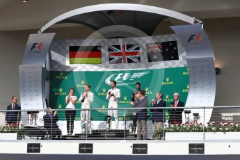 World © Octane Photographic Ltd. Mercedes AMG Petronas – Lewis Hamilton (1st) and Nico Rosberg (2nd) and Red Bull Racing – Daniel Ricciardo (3rd) with Victoria Vowels - Mercedes Partner Services Director. Sunday 23rd October 2016, F1 USA Grand Prix Podium, Austin, Texas – Circuit of the Americas (COTA). Digital Ref :1750LB1D4285