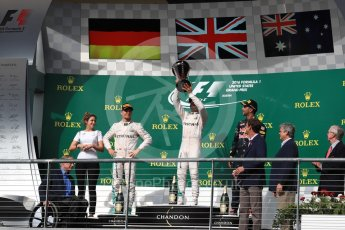 World © Octane Photographic Ltd. Mercedes AMG Petronas – Lewis Hamilton (1st) and Nico Rosberg (2nd) and Red Bull Racing – Daniel Ricciardo (3rd) with Victoria Vowels - Mercedes Partner Services Director. Sunday 23rd October 2016, F1 USA Grand Prix Podium, Austin, Texas – Circuit of the Americas (COTA). Digital Ref :1750LB1D4330