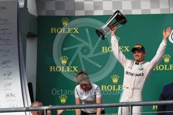 World © Octane Photographic Ltd. Mercedes AMG Petronas – Nico Rosberg (2nd) with Victoria Vowels - Mercedes Partner Services Director. Sunday 23rd October 2016, F1 USA Grand Prix Podium, Austin, Texas – Circuit of the Americas (COTA). Digital Ref :1750LB1D4373