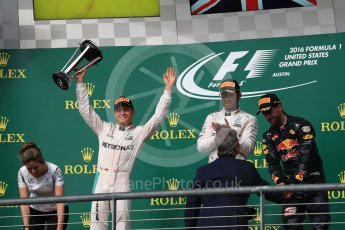 World © Octane Photographic Ltd. Mercedes AMG Petronas – Lewis Hamilton (1st) and Nico Rosberg (2nd) and Red Bull Racing – Daniel Ricciardo (3rd) with Victoria Vowels - Mercedes Partner Services Director. Sunday 23rd October 2016, F1 USA Grand Prix Podium, Austin, Texas – Circuit of the Americas (COTA). Digital Ref :1750LB1D4379