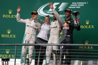 World © Octane Photographic Ltd. Mercedes AMG Petronas – Lewis Hamilton (1st) and Nico Rosberg (2nd) and Red Bull Racing – Daniel Ricciardo (3rd) with Victoria Vowels - Mercedes Partner Services Director. Sunday 23rd October 2016, F1 USA Grand Prix Podium, Austin, Texas – Circuit of the Americas (COTA). Digital Ref :1750LB1D4596
