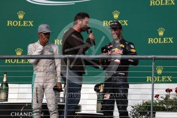 World © Octane Photographic Ltd. Gerard Butler with Mercedes AMG Petronas – Lewis Hamilton (1st) and Red Bull Racing – Daniel Ricciardo (3rd). Sunday 23rd October 2016, F1 USA Grand Prix Podium, Austin, Texas – Circuit of the Americas (COTA). Digital Ref :1750LB1D4640