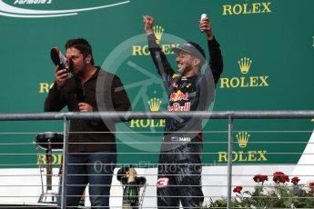 World © Octane Photographic Ltd. Gerard Butler drinks from the race boot of Red Bull Racing's Daniel Ricciardo (3rd). Sunday 23rd October 2016, F1 USA Grand Prix Podium, Austin, Texas – Circuit of the Americas (COTA). Digital Ref :1750LB1D4707