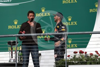 World © Octane Photographic Ltd. Gerard Butler with Red Bull Racing – Daniel Ricciardo (3rd). Sunday 23rd October 2016, F1 USA Grand Prix Podium, Austin, Texas – Circuit of the Americas (COTA). Digital Ref :1750LB1D4748