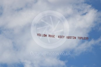 World © Octane Photographic Ltd. Formula 4 – F4 United States Championship - American Grand Prix – Race 1. Circuit of the Americas (COTA), Austin, Texas, USA. Saturday 21st October 2017. Yellow Rose - Keep Austin topless banner being flown from an aircraft. Digital Ref:1982LB1D6799