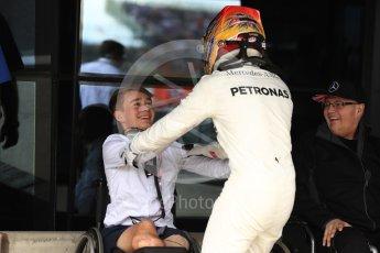 World © Octane Photographic Ltd. Formula 1 - British Grand Prix - Sunday - Race Podium. Lewis Hamilton - Mercedes AMG Petronas F1 W08 EQ Energy+ and Billy Monger #BillyWhizz. Silverstone, UK. Sunday 16th July 2017. Digital Ref: 1893LB1D4566