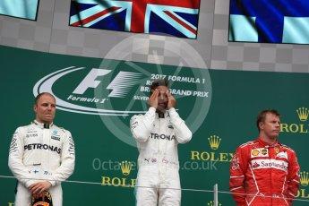 World © Octane Photographic Ltd. Formula 1 - British Grand Prix - Sunday - Race Podium. Lewis Hamilton and Valtteri Bottas - Mercedes AMG Petronas F1 W08 EQ Energy+ and Kimi Raikkonen - Scuderia Ferrari SF70H. Silverstone, UK. Sunday 16th July 2017. Digital Ref: 1893LB1D4732