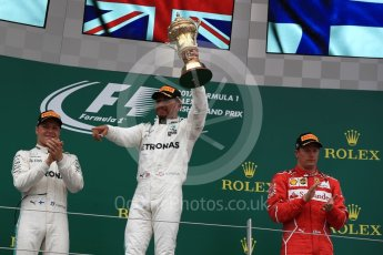 World © Octane Photographic Ltd. Formula 1 - British Grand Prix - Sunday - Race Podium. Lewis Hamilton and Valtteri Bottas - Mercedes AMG Petronas F1 W08 EQ Energy+ and Kimi Raikkonen - Scuderia Ferrari SF70H. Silverstone, UK. Sunday 16th July 2017. Digital Ref: 1893LB1D4869