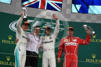 World © Octane Photographic Ltd. Formula 1 - British Grand Prix - Sunday - Race Podium. Lewis Hamilton and Valtteri Bottas - Mercedes AMG Petronas F1 W08 EQ Energy+ and Kimi Raikkonen - Scuderia Ferrari SF70H. Silverstone, UK. Sunday 16th July 2017. Digital Ref: 1893LB1D5149
