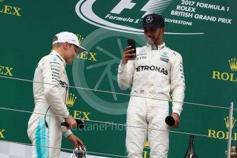 World © Octane Photographic Ltd. Formula 1 - British Grand Prix - Sunday - Race Podium. Lewis Hamilton and Valtteri Bottas Mercedes AMG Petronas F1 W08 EQ Energy+. Silverstone, UK. Sunday 16th July 2017. Digital Ref: 1893LB1D5274
