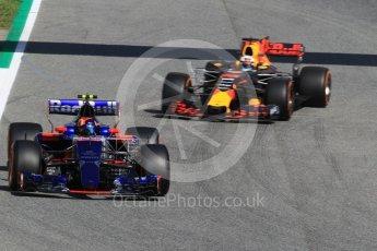 World © Octane Photographic Ltd. Formula 1 - Spanish Grand Prix Practice 1. Carlos Sainz - Scuderia Toro Rosso STR12 and Daniel Ricciardo - Red Bull Racing RB13. Circuit de Barcelona - Catalunya, Spain. Friday 12th May 2017. Digital Ref: 1810CB1L7780