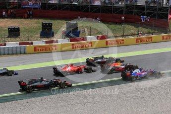 World © Octane Photographic Ltd. Formula 1 - Spanish Grand Prix Race. Sainz, Magnussen and Grosjean splits around the slow moving damaged Raikkonen and Verstappen. Circuit de Barcelona - Catalunya, Spain. Sunday 14th May 2017. Digital Ref:1825LB1D3874