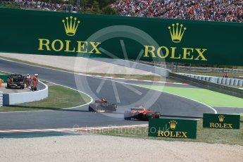 World © Octane Photographic Ltd. Formula 1 - Spanish Grand Prix Race. Max Verstappen - Red Bull Racing RB13 and Kimi Raikkonen with broken steering - Scuderia Ferrari SF70H limp back to the pits. Circuit de Barcelona - Catalunya, Spain. Sunday 14th May 2017. Digital Ref:1825LB1D4006