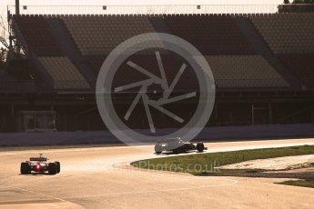 World © Octane Photographic Ltd. Formula 1 - Winter Test 1. Nico Hulkenberg - Renault Sport F1 Team R.S.17 and Sebastian Vettel - Scuderia Ferrari SF70H. Circuit de Barcelona-Catalunya. Monday 27th February 2017. Digital Ref : 1780CB1D3516