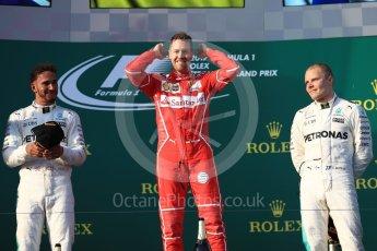 World © Octane Photographic Ltd. Formula 1 - Australian Grand Prix - Podium. Sebastian Vettel - Scuderia Ferrari SF70H, Lewis Hamilton and Valtteri Bottas - Mercedes AMG Petronas F1 W08 EQ Energy+. Albert Park Circuit. Sunday 26th March 2017. Digital Ref: 1803LB1D7520
