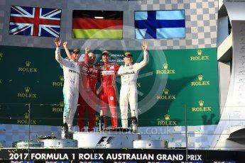 World © Octane Photographic Ltd. Formula 1 - Australian Grand Prix - Podium. Sebastian Vettel - Scuderia Ferrari SF70H, Lewis Hamilton and Valtteri Bottas - Mercedes AMG Petronas F1 W08 EQ Energy+. Albert Park Circuit. Sunday 26th March 2017. Digital Ref: 1803LB1D7846