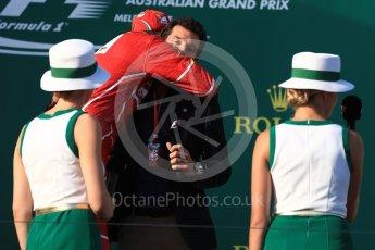 World © Octane Photographic Ltd. Formula 1 - Australian Grand Prix - Podium. Sebastian Vettel - Scuderia Ferrari SF70H hugs Mark Webber. Albert Park Circuit. Sunday 26th March 2017. Digital Ref: 1803LB1D7917