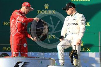 World © Octane Photographic Ltd. Formula 1 - Australian Grand Prix - Podium. Sebastian Vettel - Scuderia Ferrari SF70H and Valtteri Bottas - Mercedes AMG Petronas F1 W08 EQ Energy+. Albert Park Circuit. Sunday 26th March 2017. Digital Ref: 1803LB1D7991