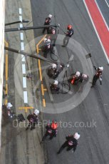 World © Octane Photographic Ltd. Formula 1 - Winter Test 2. Romain Grosjean - Haas F1 Team VF-17 and team doing a pit stop. Circuit de Barcelona-Catalunya. Friday 10th March 2017. Digital Ref: 1787LB5D0124