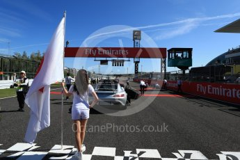 World © Octane Photographic Ltd. Formula 1 - Japanese Grand Prix - Sunday - Japanese Flag and Mercedes AMG GTs Safety Car on the grid. Suzuka Circuit, Suzuka, Japan. Sunday 8th October 2017. Digital Ref:1979LB2D5314
