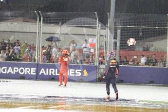 World © Octane Photographic Ltd. Formula 1 - Singapore Grand Prix - Race. Max Verstappen and Kimi Raikkonen walk away from their wrecked Red Bull Racing RB13 and Scuderia Ferrari SF70H. Marina Bay Street Circuit, Singapore. Sunday 17th September 2017. Digital Ref: