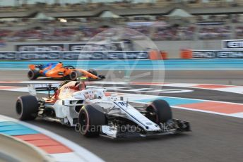 World © Octane Photographic Ltd. Formula 1 – Abu Dhabi GP - Qualifying. Alfa Romeo Sauber F1 Team C37 – Charles Leclerc and McLaren MCL33 – Fernando Alonso. Yas Marina Circuit, Abu Dhabi. Saturday 24th November 2018.