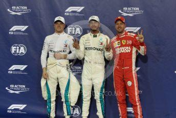 World © Octane Photographic Ltd. Formula 1 –  Abu Dhabi GP - Qualifying. Mercedes AMG Petronas Motorsport AMG F1 W09 EQ Power+ - Lewis Hamilton and Valtterri Bottas with Scuderia Ferrari SF71-H – Sebastian Vettel. . Yas Marina Circuit, Abu Dhabi. Saturday 24th November 2018.