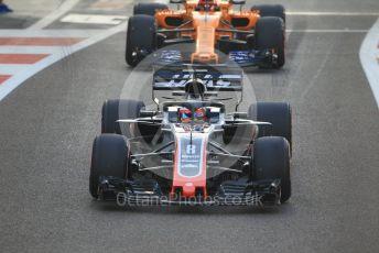 World © Octane Photographic Ltd. Formula 1 –  Abu Dhabi GP - Race. Haas F1 Team VF-18 – Romain Grosjean and McLaren MCL33 – Stoffel Vandoorne. Yas Marina Circuit, Abu Dhabi. Sunday 25th November 2018.