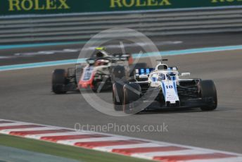 World © Octane Photographic Ltd. Formula 1 – Abu Dhabi GP - Race. Williams Martini Racing FW41 – Lance Stroll and Haas F1 Team VF-18 – Kevin Magnussen. Yas Marina Circuit, Abu Dhabi. Sunday 25th November 2018.