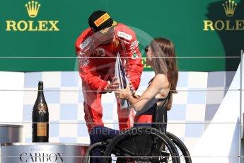 World © Octane Photographic Ltd. Formula 1 – British GP - Podium. Scuderia Ferrari SF71-H – Kimi Raikkonen and Nathalie McGloin - President of the FIA Disability and Accessibility Commission. Silverstone Circuit, Towcester, UK. Sunday 8th July 2018.