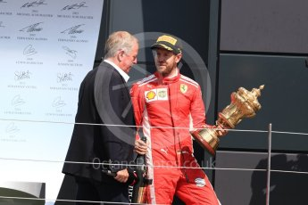World © Octane Photographic Ltd. Formula 1 – British GP - Podium. Scuderia Ferrari SF71-H – Sebastian Vettel and Martin Brundel. Silverstone Circuit, Towcester, UK. Sunday 8th July 2018.