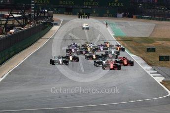 World © Octane Photographic Ltd. Formula 1 – British GP - Race. Race start Vettel's Ferrari leads Hamilton's Mercedes. Silverstone Circuit, Towcester, UK. Sunday 8th July 2018.