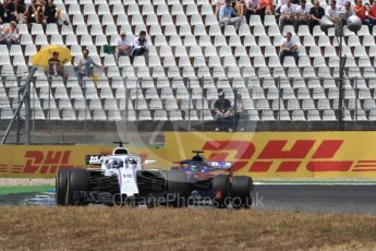 World © Octane Photographic Ltd. Formula 1 – German GP - Race. Williams Martini Racing FW41 – Lance Stroll and Scuderia Toro Rosso STR13 – Brendon Hartley. Hockenheimring, Baden-Wurttemberg, Germany. Sunday 22nd July 2018.