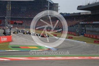 World © Octane Photographic Ltd. Formula 1 – German GP - Race. Race start and Scuderia Ferrari SF71-H – Sebastian Vettel holds the lead. Hockenheimring, Baden-Wurttemberg, Germany. Sunday 22nd July 2018.