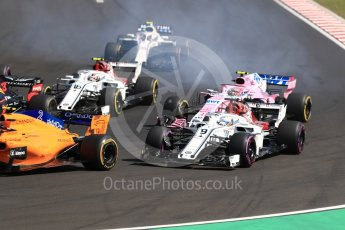 World © Octane Photographic Ltd. Formula 1 – Hungarian GP - Race. Alfa Romeo Sauber F1 Team C37 – Marcus Ericsson and Sahara Force India VJM11 - Esteban Ocon. Hungaroring, Budapest, Hungary. Sunday 29th July 2018.