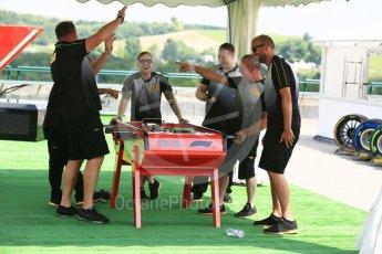 "World © Octane Photographic Ltd. Formula 1 - Hungarian GP - Paddock. Pirelli technicians playing F1 table football ""Feel the blood boil"". Hungaroring, Budapest, Hungary. Friday 27th July 2018."